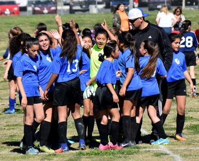 Coach Lomeli and the California United U-12 Girls getting a break after their win at home against Oxnard National. Photo Courtesy Martin Hernandez.