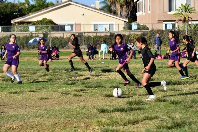Constantly applying pressure, California United's Tori Pina sprints up the field as her teammate Jadon Rodriguez (back left) keeps pace looking for a chance to score. Photo Courtesy of Evelia Hernandez.