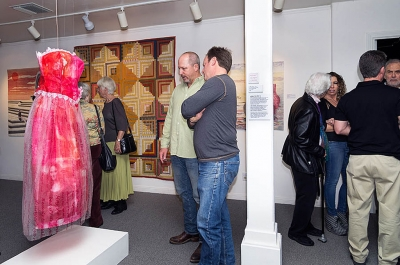 Two visitors viewing the Linda Taylor dress. Photographer Les Dublin