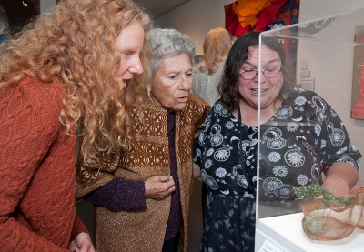 "Visitors Viewing Artist Gerri McMillins ""Zooid"" Basketry. Photographer Myrna Cambianica"