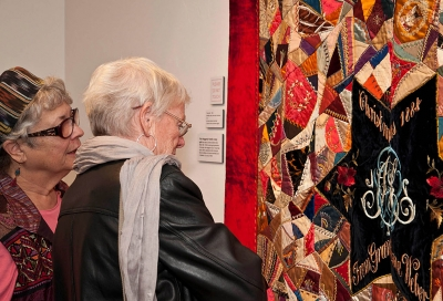 Visitors Viewing 1884 Haggerty Crazy Quilt. Photographer Myrna Cambianica