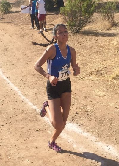 Nicole Gonzalez races into a third place finish at the Citrus Coast League Finals.