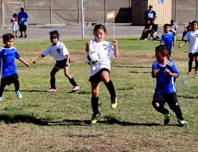 Pictured above is California United's 2013 Girls player as she gets control of the ball to dribble it up the field during their game this past weekend against Oxnard Revolution. Photos courtesy Nancy Vaca.