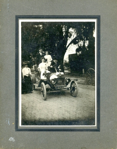 Dr. Hinckley's first car with wife Fannie (c) 1909.