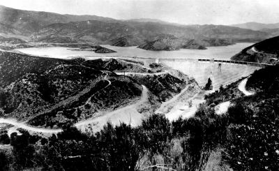 The St. Francis Dam in San Francisquito Canyon east of Castaic a few days before the collapse when it had just been filled to capacity. At three minutes to midnight on March 12th, 1928 the dam collapsed without warning causing a flood through the Santa Clara River Valley.