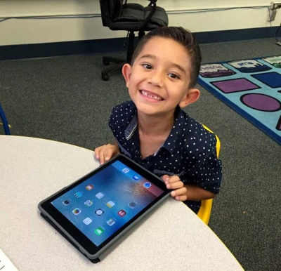 Piru Elelmentry student is all smiles about the school's new iPads.