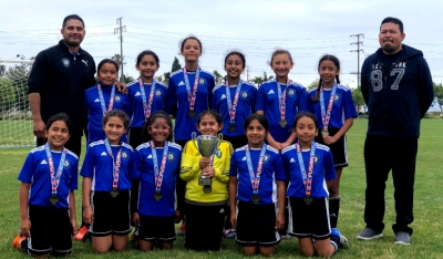 Pictured is the Fillmore's California United 2008 Girls Soccer Team. Top row (l-r) Head Coach David Vaca, Anel Castillo, Alondra Leon, Lizbeth Mendez, Valerie Rubio, Jazleen Vaca, Nathalia Orozco, and Assistant Coach Aciano Mendez. Bottom row (l-r) Jiselle Posadas, Leanna Villa, Joelle Rodriguez, Delila Ramirez, Sara Diaz, and Danna Castillo. Not pictured: Fiona Cabral and Assistant Coach John Cabral.