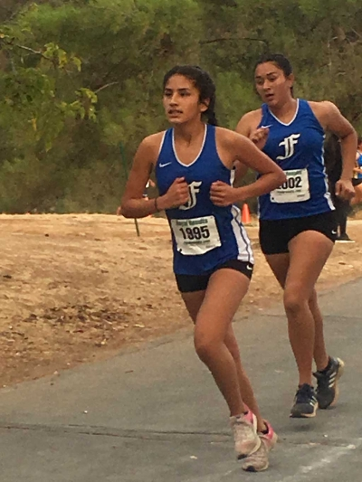 FHS teammates Isabella De La Cruz and Yakeline Magaña as they compete at the third league mini-meet to qualify for CIF