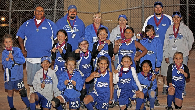 Left, a first for Fillmore Girls Softball League - The 8U team placed 2nd in the District championship game on Sunday night, the team will join the 10U and 14U in San Diego to participate in the Jr. Olympic CalState Games on July 17th, 2009. Tournament highlights include: homerun hits by Cali Wyand, Tatyana Cervantes, and Leana Venegas, triples by Tori Villegas and Tatyana Cervantes and Lindsey Brown, McKenzie Hernandez, Amanda Villa, and Cali Wyand all contributed with doubles. Leana Venegas pitched 3 1/2 games and Kasey Crawford pitched 1 and 1/2 games. Pictured left: Hailey Avila, Lindsey Brown, Tatyana Cervantes, Madeline Charles, Kasey Crawford, Jessica Harvey, McKenzie Hernandez, Chloe Stines, Leana Venegas, Amanda Villa, Victoria Villegas, and Cali Wyand, Manager Michelle Brown, Coach Leo Venegas, Coach Brian Villegas, Carlos Hernandez, Coach Carina Crawford, Coach Monique Cervantes. Photo courtesy of Richard Charles.