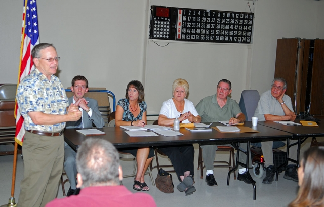 Councilman Scott Lee spoke at the June 23rd Fillmore Senior Center meeting, as liaison between the city council and the center's Board of Directors. Seated are city attorney Ted Schneider, Facilities Supervisor Annette Cardona, Boardmembers Loretta Dunehew, Bill Brunet, and Nick Robles. Brunet announced his resignation from the Board.