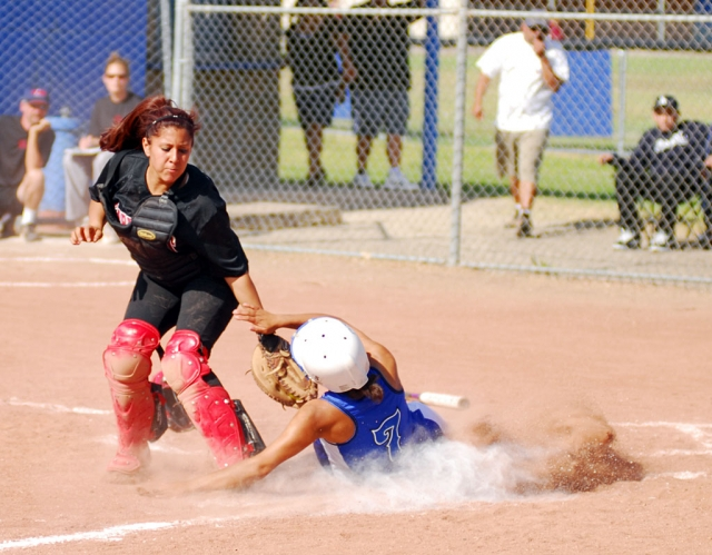 Tenea Golson tried to steal home on a base hit, but was tagged out on the throw to home.
