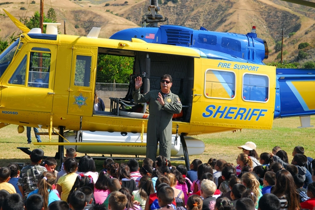 Ventura County Helicopter Pilot K.B. Bergeson visited San Cayetano Elementary in a Search & Rescue Copter, May 27th. The students were excited to see the big bird land on the back lawn and even more thrilled to be able to climb through the copter. Bergeson answered all kinds of questions and explained the copter's functions. According to Principal Jan Marholin, some of the students have been studying rotor motors and this firsthand look at the copter was a real education.