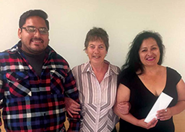 The members of the Fillmore Women's Service Club present Ramona Tovar their Adult Woman's Scholarship at their meeting in June. Attending with her was her son Jamie Delgado who we helped get his GED and is now attending Adult Job training. We are very proud of both of them.