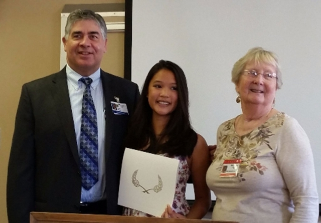 Michelle Pablo (center), with Gary Wilde, CMHS President and CEO, and CMH Auxiliary President Edie Marshall