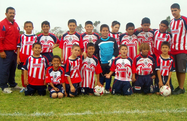 "On Saturday, June 29th ""CHIVAS FILLMORE"" a youth soccer team took 2nd place in the spring season soccer fi nals. The players are between the ages of 9 & 10. Congratulations kids. Pictured (l-r) top: Trinidad Zavala (head coach), Angel Acosta, Emilio Manzano, Mathew Fletes, Abelardo Gaitan, Josue Morga, Efren Carbajal, Richard Estrella, Felix Tinoco, Fernando Gallardo, Javier Candelario (coach assistant). Bottom (l-r): Jesse Ballesteros, Yohan Medina, Luis Ruiz, Ricky Lomeli, Christian Candelario, Marcos Savala, Anthony Castaneda, Enrique Gutierrez(missing)."