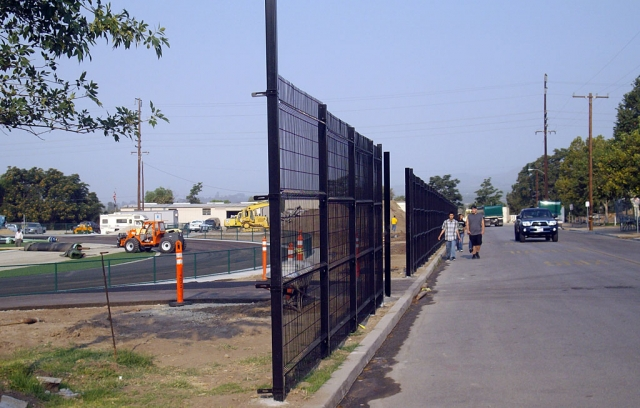 A steel fence gone up at the north end of the track field on Second Street. The fence, just inches from the curb, will present a challenge to parked car doors opening and to pedestrians forced to walk in the street as shown above.
