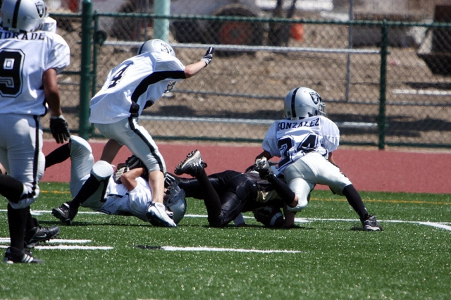 Damian Gonzalez finishes off an opposing ball carrier.