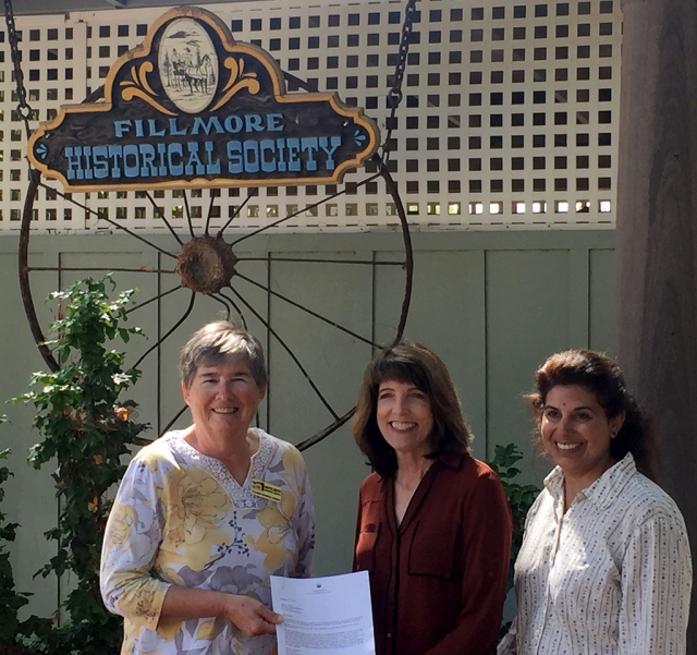 Pictured (l-r) is Martha Gentry, Executive Director Fillmore Historical Museum, receiving a $1,000 check from Leslie Klinchuch and Natasha Molla, Project Managers of Chevron Corporation.