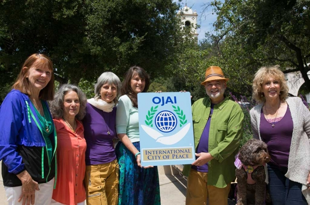 Peace Pod with Ojai Sign: Anahata Pomeroy, Julie Heyman, Lisa Berman, Kathy Nolan, Brian Berman, Dianne McCourtney, not present in photo Ray Powers and Sylvie Lee. Photo by David Baker.