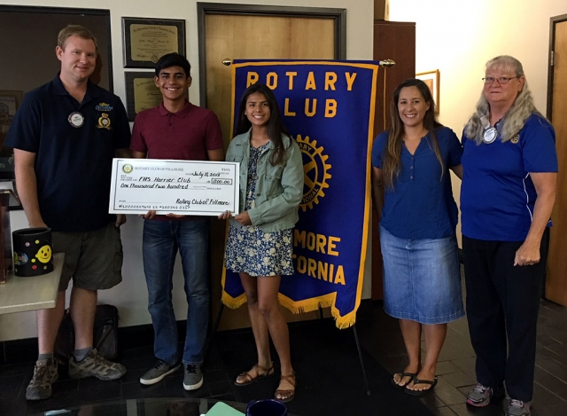 President Andy Klittich (left) presented a check for $1,200 to the FHS Harries Club. $1,000 was directly from Fillmore Rotary, $150 was from FHS Cross Country team's first place time in the 5K Run and $50 was a donation from Pro Body Fitness, from Santa Paula, who placed second in the 10K Run. Accepting the donation was Nick Villela, Vanessa Avila, and Coach Kim Tafoya and also Cindy Blatt who was Chair of the Runs. Photo courtesy Martha Richardson.