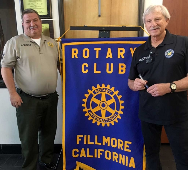 Fillmore Rotary Club President Dave Warham (left) presented Fillmore Building Inspector Michael Koroknay with a Rotary mug after his presentation about the Earthquake Brace & Bolt program. He discussed home foundations and what could happen during an earthquake. He informed the Club that homeowners can receive up to $3,000 toward an earthquake retrofit. The program is Earthquake Brace & Bolt and the timeline to apply is January 23-Feburay 23, 2018. Photo courtesy Martha Richardson.