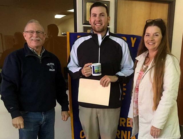 Bob Hammond, Program Chair introduced Tim Medina a FHS graduate who now works at Elkins Golf Course. Tim talked about what it takes to become a PGA Teaching Pro. President Julie presented him with a Rotary mug.