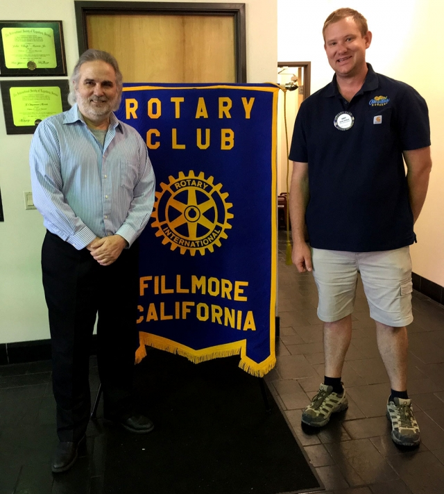 Don Price (left) standing with Rotary President Andy Klittich, presented a program on Climate Change to the Fillmore Rotary Club. Climate is long term weather, and many things contribute to it such as water resources, wild fires, sea level rise, and greenhouse gases. Moving forward the following are helping us use less fossil fuels: electric and hybrid cars, solar power and wind power. Photo courtesy Martha Richardson.