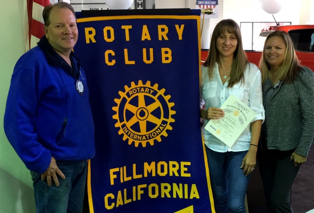 During a special ceremony Rotary Club President Ari Larson and Sponsor Scott Beylik inducted Kelli Couse into the Rotary Club of Fillmore. Photo Courtesy Martha Richardson.