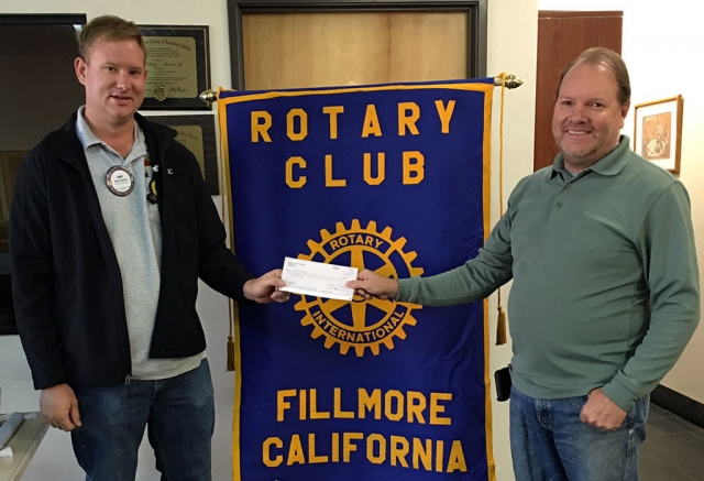 Fillmore Rotary Club donated $500 to the Fillmore Fire Foundation. Scott Beylik accepted the check from Rotary president Andy Klittich. Photo courtesy Martha Richardson.
