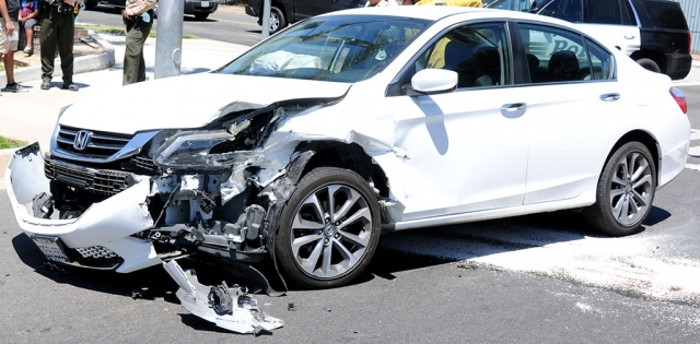 On Saturday, August 1st at 1:30pm at the corner of Ventura and B Street, a 2-car collision occurred between a white Honda Accord and a red Honda. One woman was checked at the scene for unspecified injuries. No further details were available at press time; cause of the crash is still under investigation.