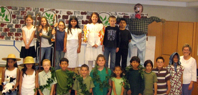 "Mrs. Anderson's 3rd grade class performed a musical ""Jack and the Beanstalk"" at Mt. Vista, Friday evening. Top Row: Katelyn, Aviana, Emma, Norma, Sarai, Scott and Anthony, Bottom Row: Lupita, Jazmin, Evan, Miguel, JJ, Mary, Jennifer, Francisco, Jacob, Cody, Alexandra, and Mrs. Anderson."