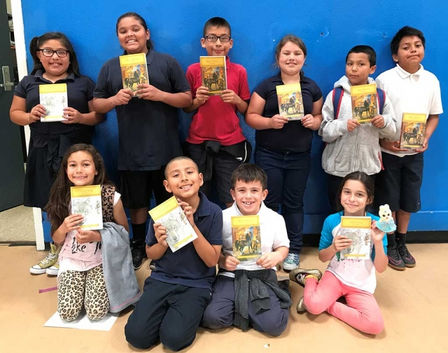 Students from the Boys & Girls Club of Santa Clara Valley smile for a photo with their recently donated art supplies from Michaels Arts & Crafts store in Ventura.