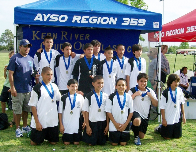 This past weekend AYSO's 14 & Under soccer team brought home the championship trophie. The tournament was held in Bakersfield. The boys played 5 games in 2 days. In pool play Fillmore beat Bakersfield 7-0, Porterville 4-1, another team from Bakersfield 10-1. In the semifinals Fillmore beat Lancaster 6-1. Fillmore beat Porterville 2-0 for the championship. The players families and friends were all there to cheer them on. The boys would liked to thank George Benz and the Law office of George Benz for helping sponsor the tournament. They would also like thank San Cayetano Principal Jan Marholin for her support. Pictured