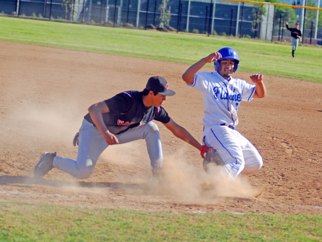 Sal Ibarra gets safely to first base before Carpinteria's first baseman tags him.