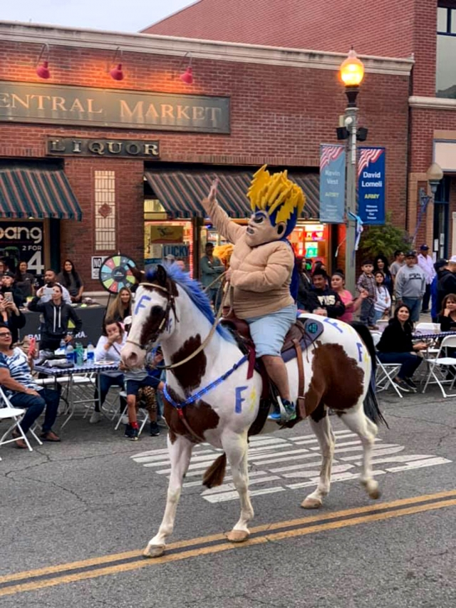 "Last Thursday, September 26th at 6:30 p.m., crowds of people lined up down Central Avenue as the Fillmore Alumni Association hosted their annual Blue & White Night and Fillmore High School's 2019 Homecoming Parade. Pictured above is the Fillmore High Mascot the ""Flashman"", as he rides in on his horse waving to the crowd, getting them pumped up for Friday night's game against Carpinteria. Photos courtesy Mark Ortega of FHS Alumni President."