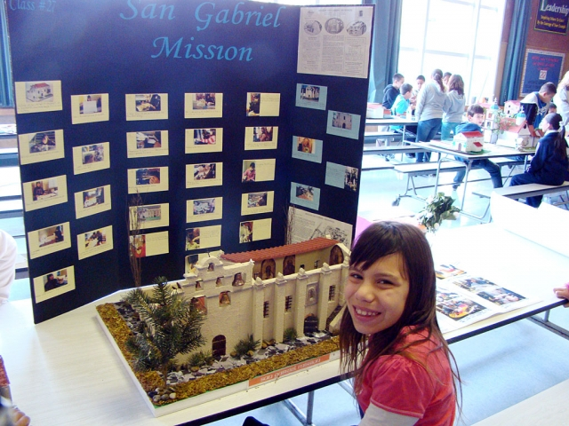 Melia Galindo is shown with her 4th grade California Mission project.
