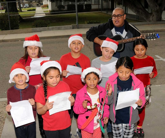 On Thursday, December 21st carolers from the Fillmore Boys and Girls Club stopped by the Fillmore Gazette and sang some Christmas Carols to the staff. The group walked up and down the main streets of Fillmore visiting local businesses and singing Christmas Carols to spread the Christmas spirit.