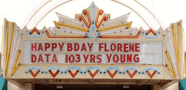 Florene Data turned a century-plus-three in May and Fillmore wants to help her celebrate. On Monday, June 8, at noon in front of Fillmore City Hall, come wish Florene a happy birthday! Instead of gifts, please go by a dollar store and pick up something patriotic; a flag, a hat, anything red, white & blue and gift it to her. Florene is famous for driving around Fillmore in her scooter, complete with the American flag flying in the wind as she cruises down Central Avenue. Fillmore's Towne Theatre marquee sends the message we all want to deliver to Florene HAPPY BIRTHDAY!