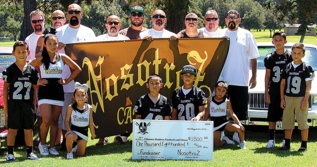 On August 3rd the Nosotroz Car Club presented athlete participants of Fillmore Youth Football & Cheer with a generous check donation of $1800 from a barbecue dinner fundraiser which was held back on June 29th, 2019. Funds will be used by the organization to ensure the safest of equipment for its participants as well as field fees for practicing and hosting of local games. The Fillmore Raiders Youth Football & Cheer would like to express their overwhelming appreciation for the continuous support of the Nosotroz Car Club. Additional recognition and appreciation to our local restaurants for their donations/contributions: El Pescador, Brenda's Casamia, La Fondita and La Michoacana. Pictured above is the Nosotroz Club with some the Fillmore Raiders Youth Football and Cheer participants. Photo courtesy Crystal Gurrola, information courtesy Fillmore Raiders Youth Football and Cheer.