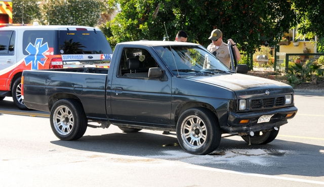Pictured above is the black older Nissan truck that rear-ended the Toyota 4-door sedan.