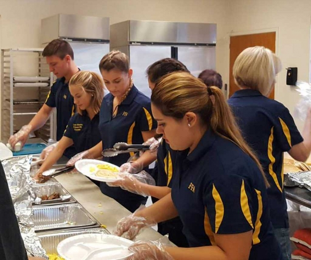 On Saturday, May 20th Fillmore FFA hosted their Annual May Festival Pancake Breakfast at the Veterans Memorial Building. Pictured above are FFA Students working hard the kitchen during their annual fundraiser.
