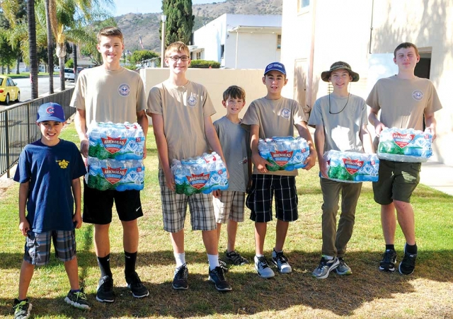 On Monday August 15th, Fillmore Boy Scout Troop 406 was asked to store emergency water for Red Cross.