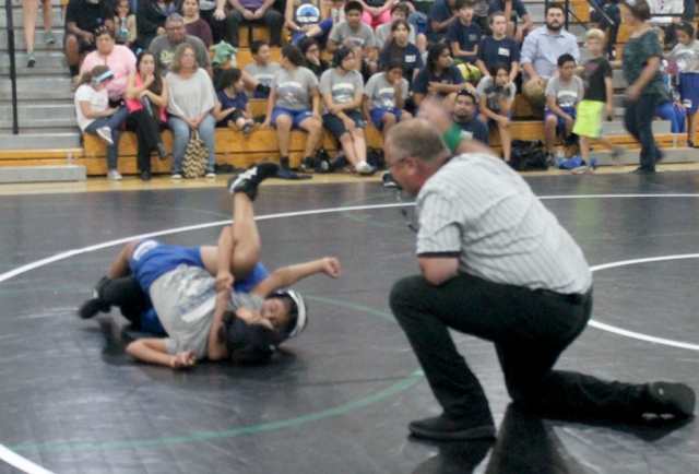 The Fillmore Middle School Wrestling Team recently competed at Sinaloa Middle School in Simi Valley. Other schools that competed in the 4-team competition included Isbell Middle School and Soria Middle School. The results are as follows: Emma Torres 2-0, Alexa Martinez 1-1, Devin Camacho 0-1, Meya Garcia 0-1, and Jonathan Patino 0-1. Pictured above is Fillmore's Emma Torres during her match in Simi Valley taking down her opponent. Photos courtesy Coach Michael Torres.