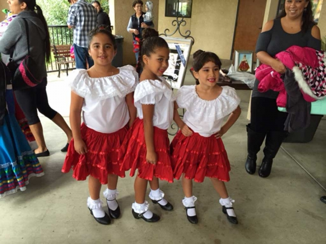 "The Saint Francis of Assisi Festival, held two weeks ago, drew one of it's largest crowds, despite the rain. Folklorico dancers and little senioritas were more than happy to pose for the camera. ""Let them praise his name with dancing and make music to him with tambourine and harp."" Psalm 149:3"