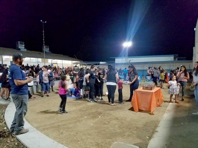 On Thursday, October 26th from 5pm-8pm Kids and parents dressed in their costumes and excitedly headed down to the annual Harvest Festival at San Cayetano Elementary, which included food, games, and activities.