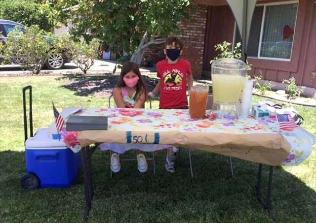 The perfect thing on a hot July 4th day is lemonade, and two kids had the right idea, setting up a lemonade stand in their yard at the corner of Fourth Street & Central Avenue in Fillmore.