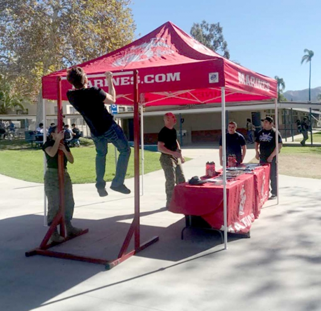 Last week during lunch at Fillmore High School the US Marine Corps set up a Pull Up Challenge for the students to compete as well as learn about the Marines. Photo courtesy Katrionna Furness.