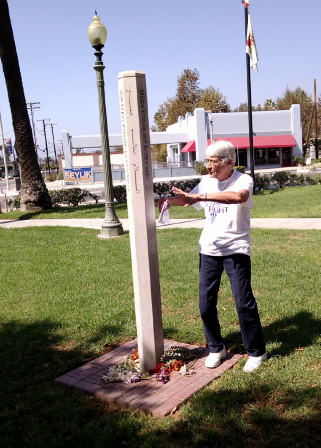 A group gathered around the Fillmore Peace Pole in Fillmore City Park on September 21 to remind us all of the need for peace in our families, our community, our nation and the world.  The Peace Pole was installed in 2009 by the Fillmore Sorptimist Club under the leadership of Sarah Hansen.  It has engraved into the pole