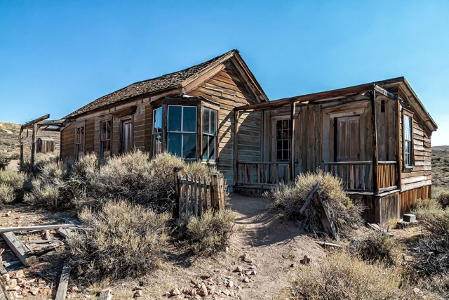 "Photo of the Week ""Bodie ghost town home complete with outhouse"" by Bob Crum. Photo data: Canon camera, manual mode, Tamron 16-300mm lens @15mm. Exposure; ISO 320, aperture f/.9.5, 1/250sec shutter speed."