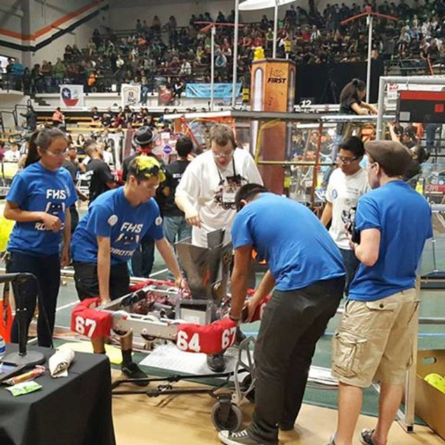 "After a very productive round the Flashes team carry ""Mr. Roboto,"" off the field and back to the pit."